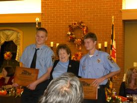 David Dean and Kyle Barnaby receiving the firefighters of the year award from Southern Maryland NewsNet.