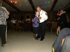 A final dance with the wife. She is the short one.