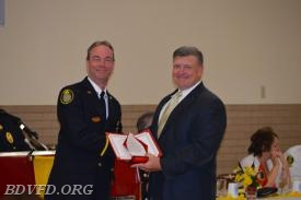 Fire Chief Joe Gould accepting an award for fire prevention from the Deputy Chief State Fire Marshal  Duane Svites of the Southern Regional office.