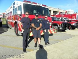 The duty crew from 13 standing by with the engine. One of our old guys in the middle and don't ask me how to spell his name.