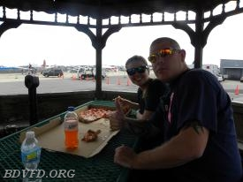 Firefighters doing what they do best eating pizza is C.J. Mattingly and Leah Vallandingham of Company 13. We had some to and it was so good.