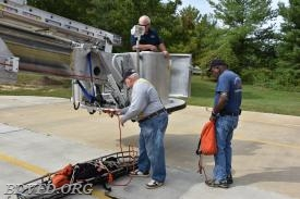 Jimmy in the bucket with Keith and Tod Jackson working on the ground.