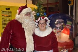 Our Santa (Gary Hanbury) and Mrs. Claus (Jamie McClane) posing for smug mug the photographer.