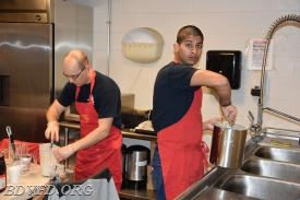 Two of the seafarers working on the pancakes.