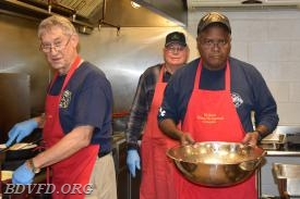 Three of our Geritol crew Bruce Theden, Tod Jackson and the egg man Melvin Tennyson working the kitchen.
