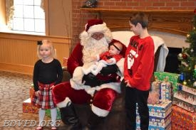 Look at that little one in Santa's arms.