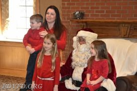 What a great shot of Ms. Waikart and her beautiful family with Santa.