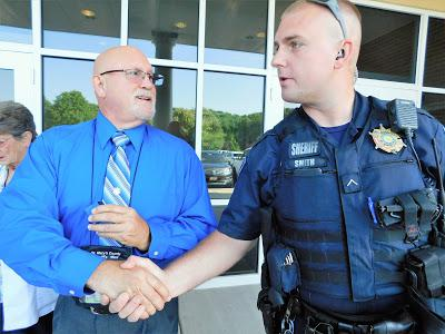DFC Jason Smith congratulates Jeff McLane.   Courtesy St. Mary's County Sheriff's Office Website