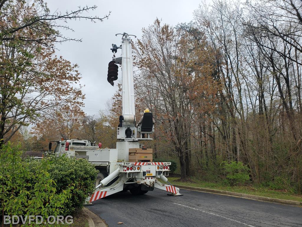 SMECO operator preparing to remove pole.