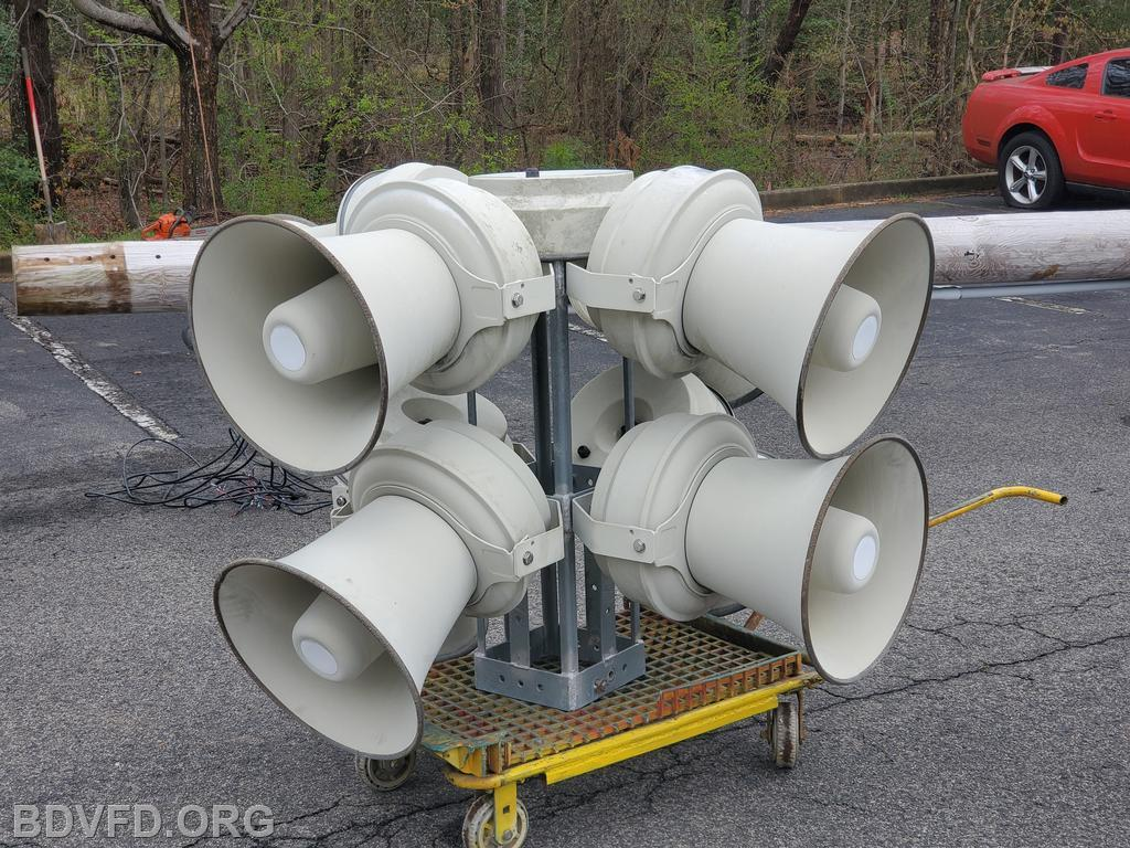 The siren speakers that sit on top of the pole. It has 8 cones, each with four speakers.