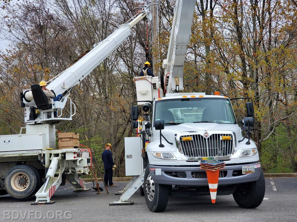 SMECO trucks setting the new pole in place and mounting the wires, hardware and antenna.